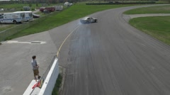 Beige cars drift close to barrier top view3- ShannonVille RaceTrack May 19th Stock Footage
