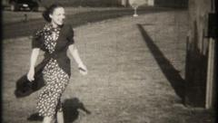 2050 - fashionable, pretty women outside on a windy day -vintage film home movie Stock Footage