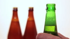 Stock Video Footage of Green beer bottle in human hand, taking a sip and putting in place