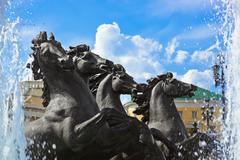 "Fountain with horses ""Four Seasons"" on Manezh Square - Moscow Russia Stock Photos"