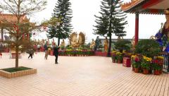 Main Plaza and thousand arms golden Buddha sculpture in open air - stock footage