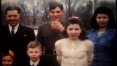 2053 - military family gathers for photo - vintage film home movie Arkistovideo