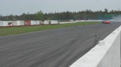 Orange cars speed down straight - ShannonVille RaceTrack May 19th Stock Footage