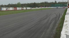 Red Cars drift then speeds down straight - ShannonVille RaceTrack May 19th - stock footage