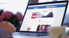 Stock Video Footage of People in the office reads the news on the website facebook cnn