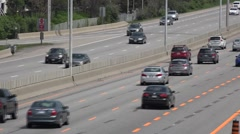 Traffic on a 4 lane highway Stock Footage