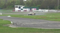 Beige car drifts through corners - ShannonVille RaceTrack May 19th Stock Footage