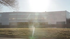 Shiney White Business Building with Pond Lens Flare Stock Footage
