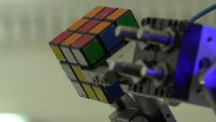 Robot.  AI. Robot collects Rubik's cube. New technologies. Stock Footage
