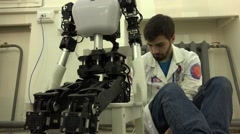 Robot. AI.  The robot and its creator. New technologies. - stock footage