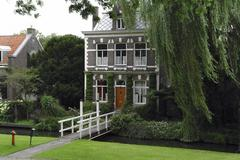 Dutch house with willow trees, southern Holland Stock Photos