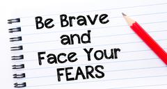 Text written on notebook page Be Brave and Face Your Fears  - stock photo