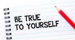Text written on notebook page Be True To Yourself  - stock photo