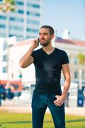 Handsome sexy and casual young man with cellphone talking Stock Photos