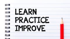 Text written on notebook page Learn, Practice, Improve  - stock photo