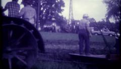 2059 - old tractor plows farm fields - vintage film home movie Stock Footage