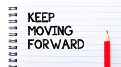 Text written on notebook page Keep Moving Forward  - stock photo