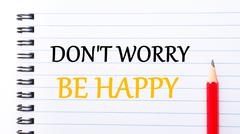Text written on notebook page Do Not Worry Be Happy Stock Photos