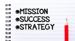 Text written on notebook page Mission, Success, Strategy  - stock photo