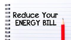 Text written on notebook page Reduce Your Energy Bill  - stock photo