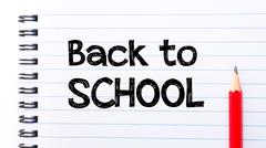 Text written on notebook page Back to School - stock photo