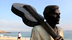 Brazilian composer Tom Jobim's statue. Ipanema, Rio de Janeiro, Brazil Stock Footage
