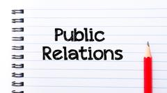 Stock Photo of Text written on notebook page Public relations