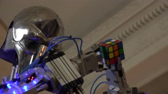 New technologies. Robot.  AI. Robot collects Rubik's cube. - stock footage
