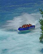 Huka Jet boat at Huka Falls near Taupo Waikato River New Zealand Stock Photos