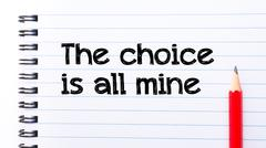 The Choice is All Mine Text written on notebook page, red pencil on the right - stock photo