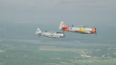 North American T-6 Texan warbirds performing at EAA AirVenture Oshkosh Stock Footage