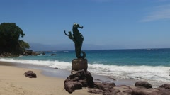 "Original,  ""The Boy on the Seahorse"" Statue, beach, Puerto Vallarta, Jalisco, - stock footage"
