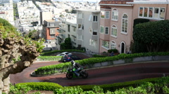 Stock Video Footage of Motor driving the famously Lombard Crooked Street in San Francisco
