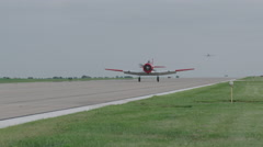 North American T-6 Texan warbird taxiing on runway of Wittman Regional Airport Stock Footage