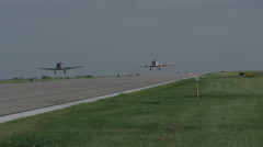 Two North American T-6 Texan warbirds taking off from Wittman Regional Airport - stock footage