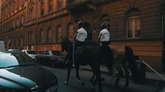 Mounted Police - Riding in City Stock Footage