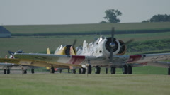 North American T-6 Texan warbirds on runway of Wittman Regional Airport - stock footage
