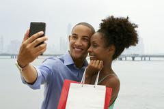 African American Couple Shopping Taking Selfie With Mobile Phone Stock Photos