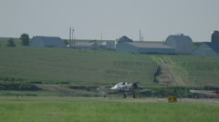North American T-6 Texan warbirds taxiing on runway of Wittman Regional Airport - stock footage