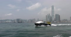 Passenger ferry boat cruising past the ICC Tower in Hong Kong - stock footage