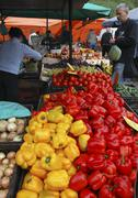 Vegetable market stall with red and yellow capsicum peppers Stock Photos