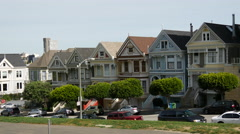 Cars driving by the Painted ladies in San Francisco Stock Footage
