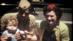 2068 - young military family pose for the camera - vintage film home movie Arkistovideo