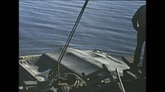 Vintage 16mm film, working on river barge, wartime Alaska 1943 Stock Footage