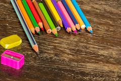 Sort crayons flooring surfaces, bright colors, red, yellow, black, orange and - stock photo