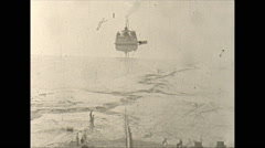Vintage 16mm film, barge pulling oilpipe pan, wartime Alaska 1943 Stock Footage