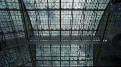 clouds pass quickly over the glass roof of building-timelapse - stock footage