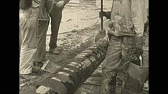 Vintage 16mm film, pipe tarring sealing, 3-shot , wartime Alaska 1943 Stock Footage