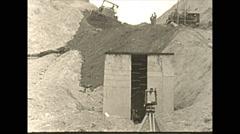 Vintage 16mm film, 1943, pulling pipe bulldozers, wartime Alaska Stock Footage