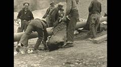 Vintage 16mm film, laying pipe, wartime Alaska 1943 Stock Footage
